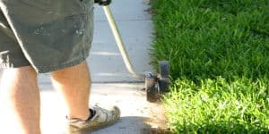 Landscaper edging sidewalk